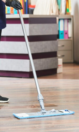 cleaning service. washing office floor surface with mop